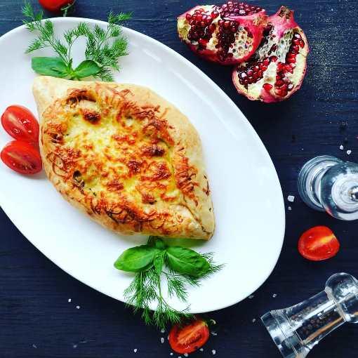 Вкуснейшие хинкали, хачапури и бокал любимой Хванчкары в TINATIN